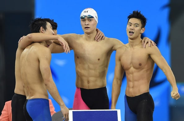 China's Sun Yang (2R) celebrates with team-mates Ning Zetao (R), Lin Yongqing and Yu Hexin after the Chinese team won the final of the men's 4 x 100m freestyle relay swimming event during the 17th Asian Games at the Munhak Park Tae-hwan Aquatics Centre in Incheon on September 24, 2014. AFP PHOTO / PHILIPPE LOPEZ (Photo credit should read PHILIPPE LOPEZ/AFP/Getty Images)